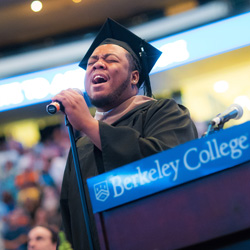 Amire Carter singing at commencement