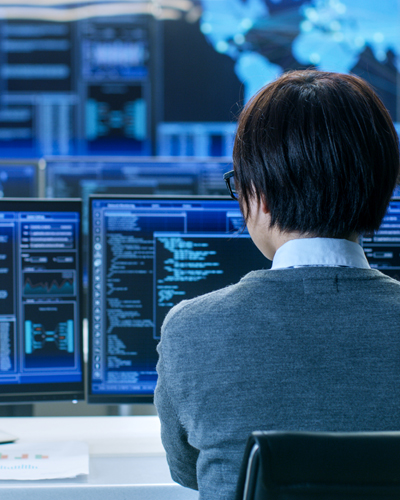 Image of a person working on a computer at a command center