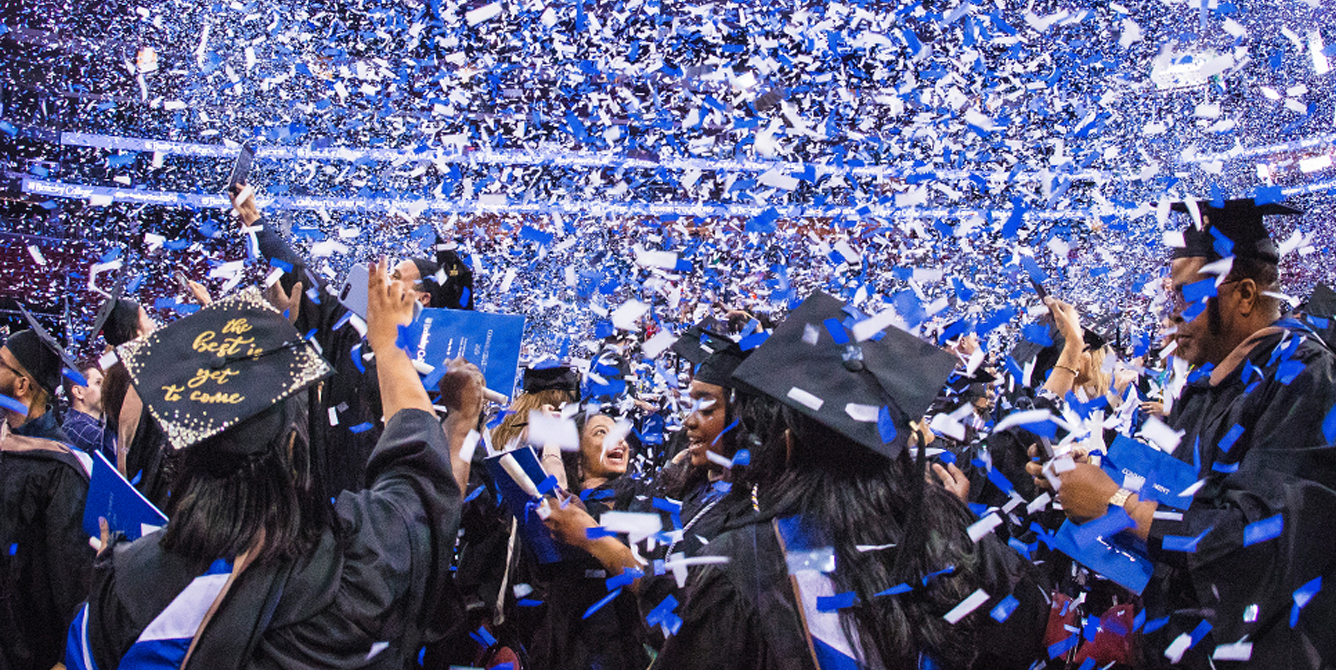 Photo of Berkeley College graduates celebrating at Commencement