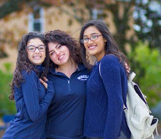 Background image of 3 Berkeley College students at the Woodland Park campus