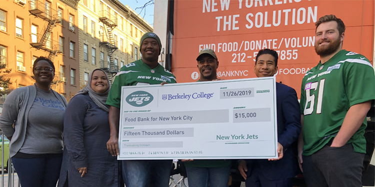 Berkeley College and the New York Jets presenting large check of $15,000 to the Food Bank of NYC