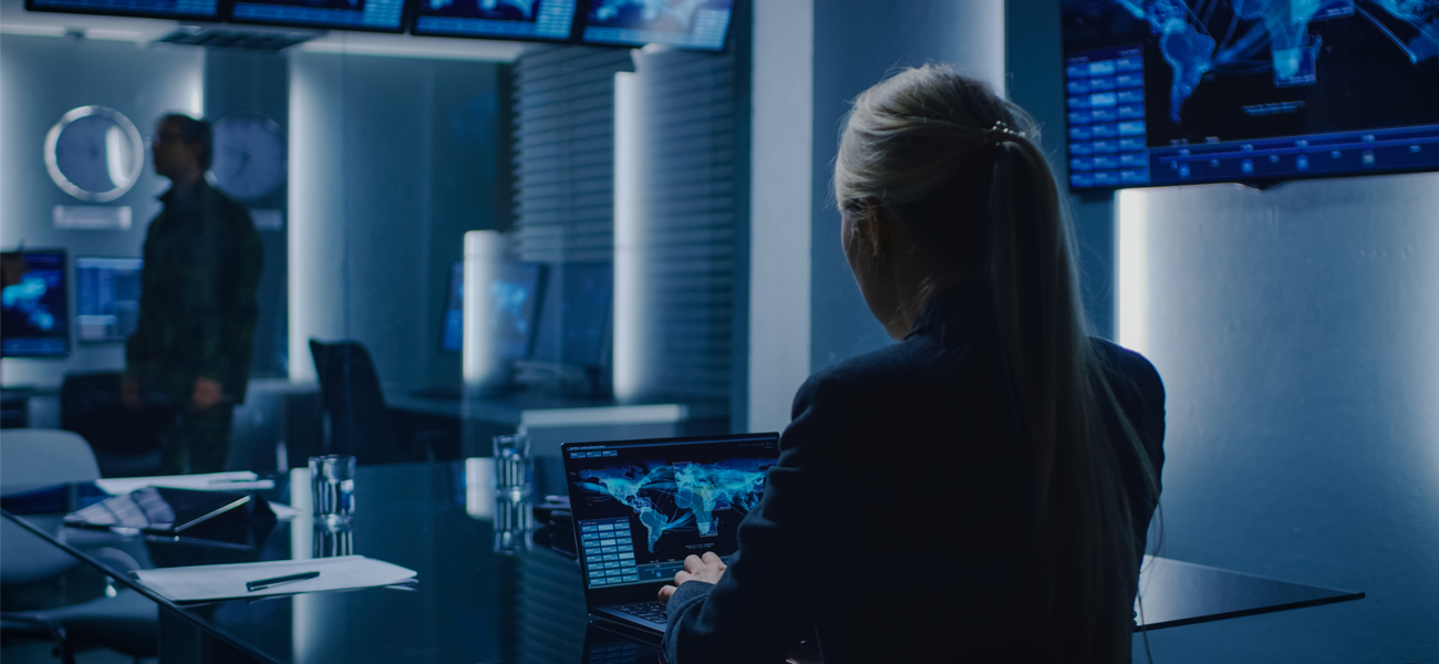 Female working on a computer in a national security office