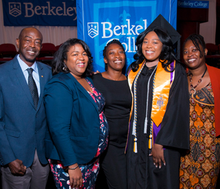 Photo of Berkeley College graduate at Commencement with family. mobile image