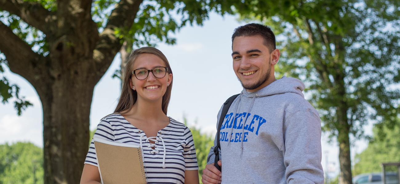 Male and female student outside