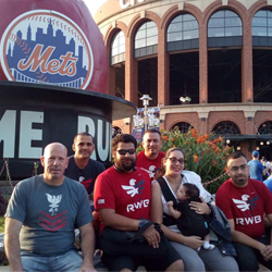 Veteran students at Mets game for check presentation